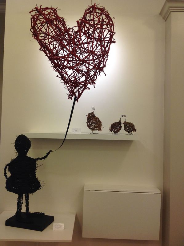 Banksy Girl sculpture, vine cane art, Kelowna